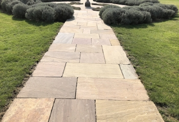 Long pathway patio after it is jet washed