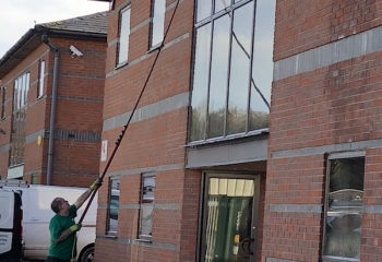 Hampshire professional member of staff doing ladderless office window cleaning